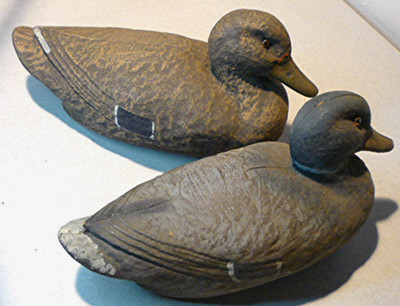 Two antique duck decoys.Male and female ducks with glass eyes. SearsRoebuck