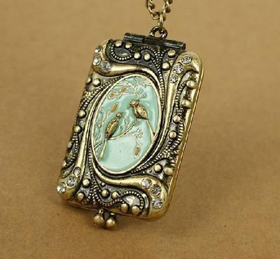 Antique Bronze Bird album Locket Pendants Necklace.