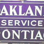 ANTIQUE ORIGINAL TWO SIDED OAKLAND SERVICE PONTIAC PORCELAIN SIGN IN GREAT COND.