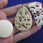 antique chinese carved ox bone pendents, box, collection of three smalls.