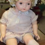 26 INCH ANTIQUE COMPOSITION DOLL GLASS EYES HAS CLOTHES