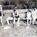 Young Men in Swimsuits, Woman & Girl in Dresses  Beach, Antique Photo